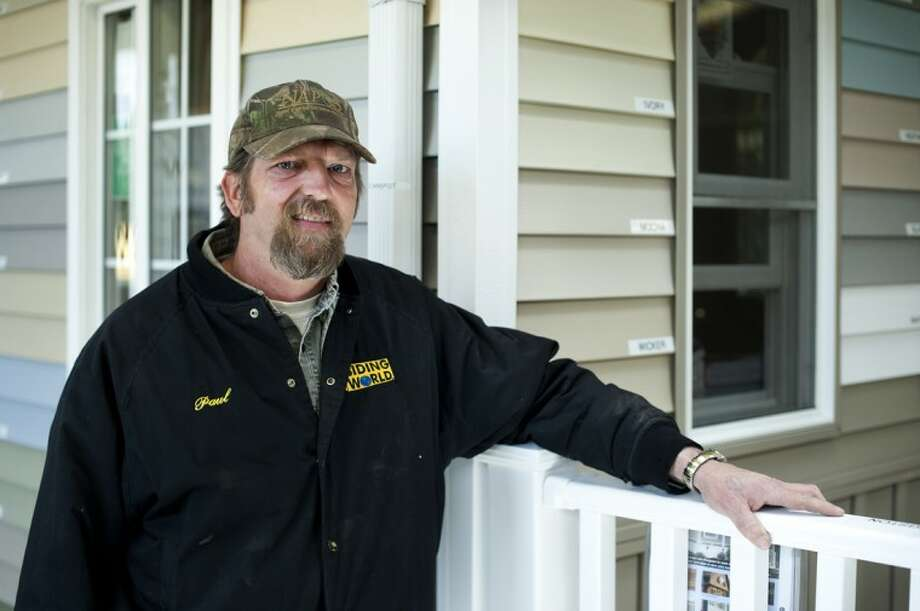 NEIL BLAKE   nblake@mdn.netSiding World assistant manager Paul Brown has been working at the business for 18 years. The business sellls LP SmartSide, a relatively new product in the housing market. Photo: Neil Blake/Midland  Daily News