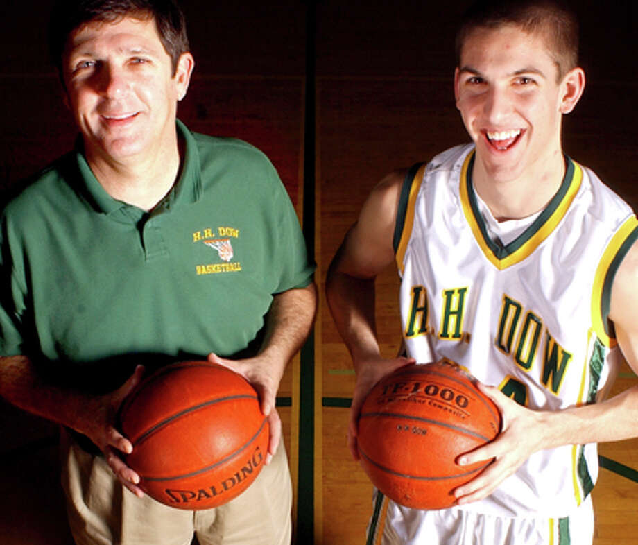 Coach Dave MacDonald, left, and his son Scott MacDonald are seen in this 2004 file photo.