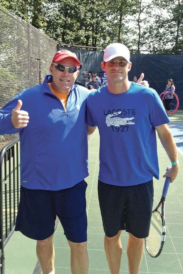 Photo providedMike Woody, executive director of the Midland Community Tennis Center, poses with Andy Roddick at the White House tennis court. While at the Easter Egg Roll, Woody got to meet President Barack Obama.