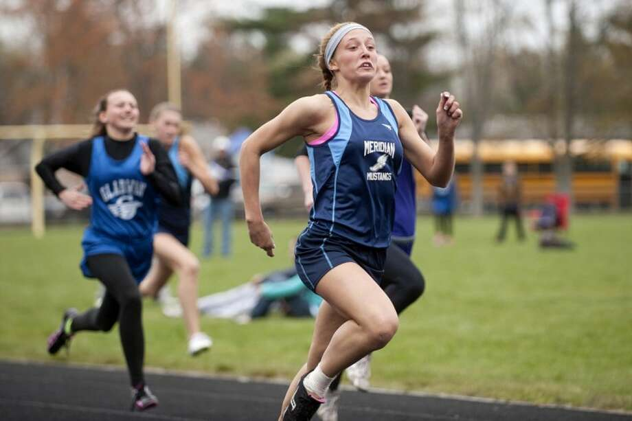 THOMAS SIMONETTI   tsimonetti@mdn.netMeridian's Amanda Decker competes in the 100 meter girls run at Meridian on Wednesday. Photo: Thomas Simonetti