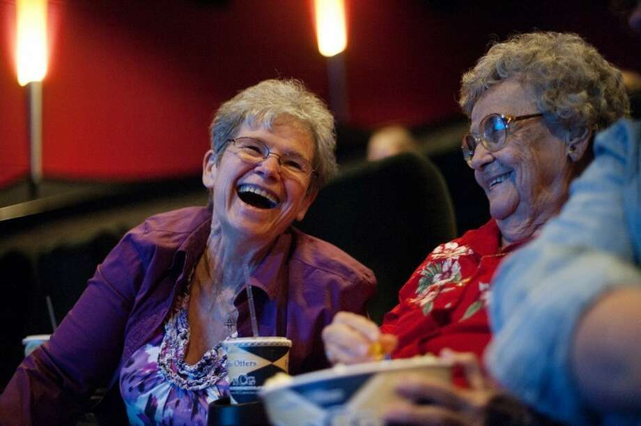 NEIL BLAKE | nblake@mdn.netSara laughs with her mother, Doris, while waiting for a movie to start at Midland Cinemas July 29. Doris also has Alzheimer's disease but is still able to live alone at age 92. Their disease manifests itself in different ways. Photo: Neil Blake