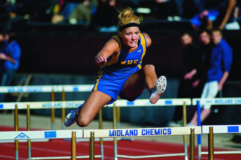 NICK KING | nking@mdn.net Midland's Jennifer Jarema competes in the 100-meter hurdles relay during the Graves/Swayze Relays Friday at Midland Community Stadium. Midland won the heat. Photo: Nick King/Midland  Daily News / Midland Daily News