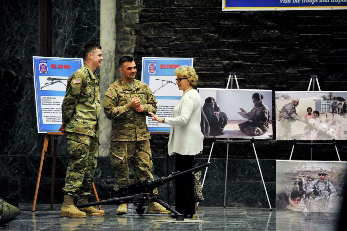 Members of the 287th Infantry 2nd Brigade Combat Team 10th Mountain Division, Pvt. Cole Hagley, left, and Pvt. Kyle Londre, center, speak with Barbara Bartoletti, legislative director for the League of Women Voters, as soldiers from Fort Drum took part in Fort Drum Day at the Legislative Office Building on Tuesday, March 22, 2016, in Albany, N.Y. The weapon on the ground is the M2 .50 caliber machine gun. (Paul Buckowski / Times Union)