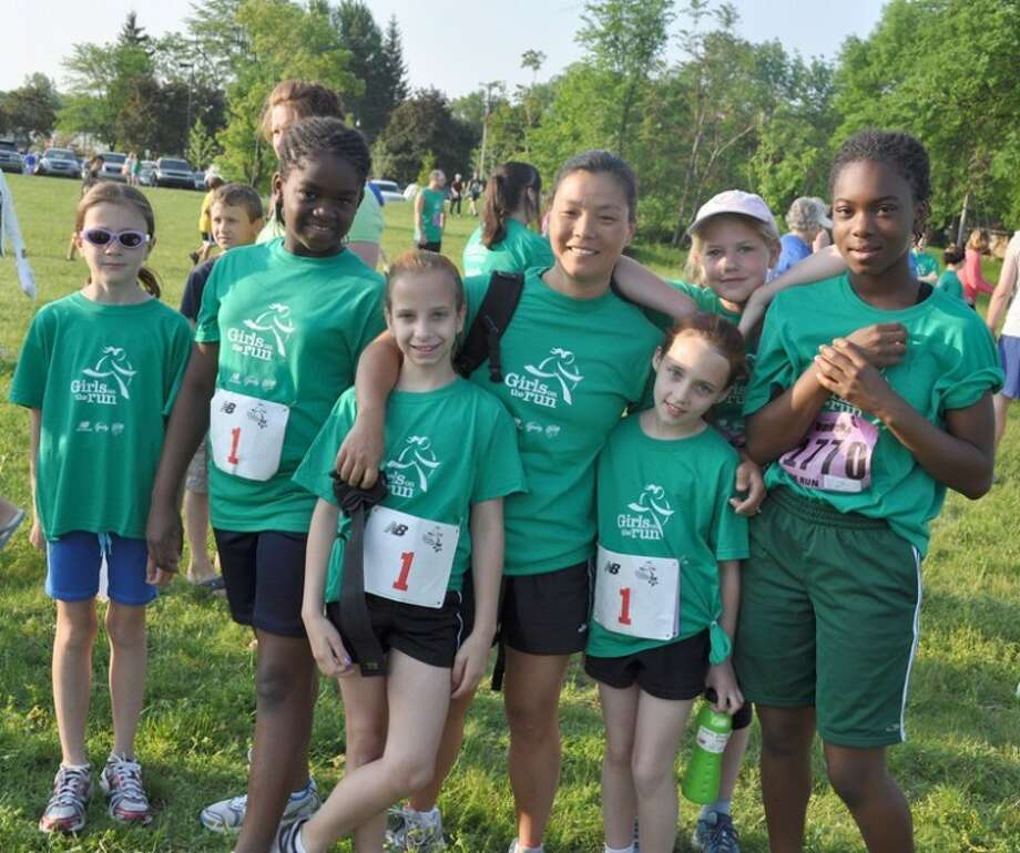 This file photo shows past participants of the Girls on the Run program.