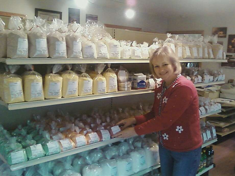 Dolores (Dee) Coston stands near some of the bulk foods at the new food store.
