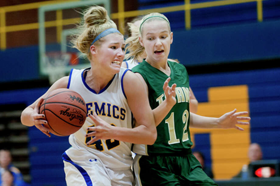 NICK KING | nking@mdn.netMidland's Jennifer Jarema, left, and Traverse City West's Kiley Kreple make contact during a fast break in the second period Friday at Midland High School. Photo: Nick King/Midland  Daily News / Midland Daily News