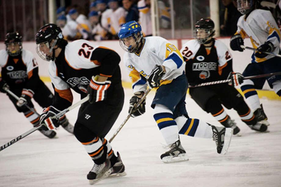 NEIL BLAKE | nblake@mdn.netMidland's Scott Naples pursues Brother Rice's Connor Duncan on Saturday at Midland Civic Arena. Midland lost 7-3. Photo: Neil Blake / Midland Daily News | Neil Blake