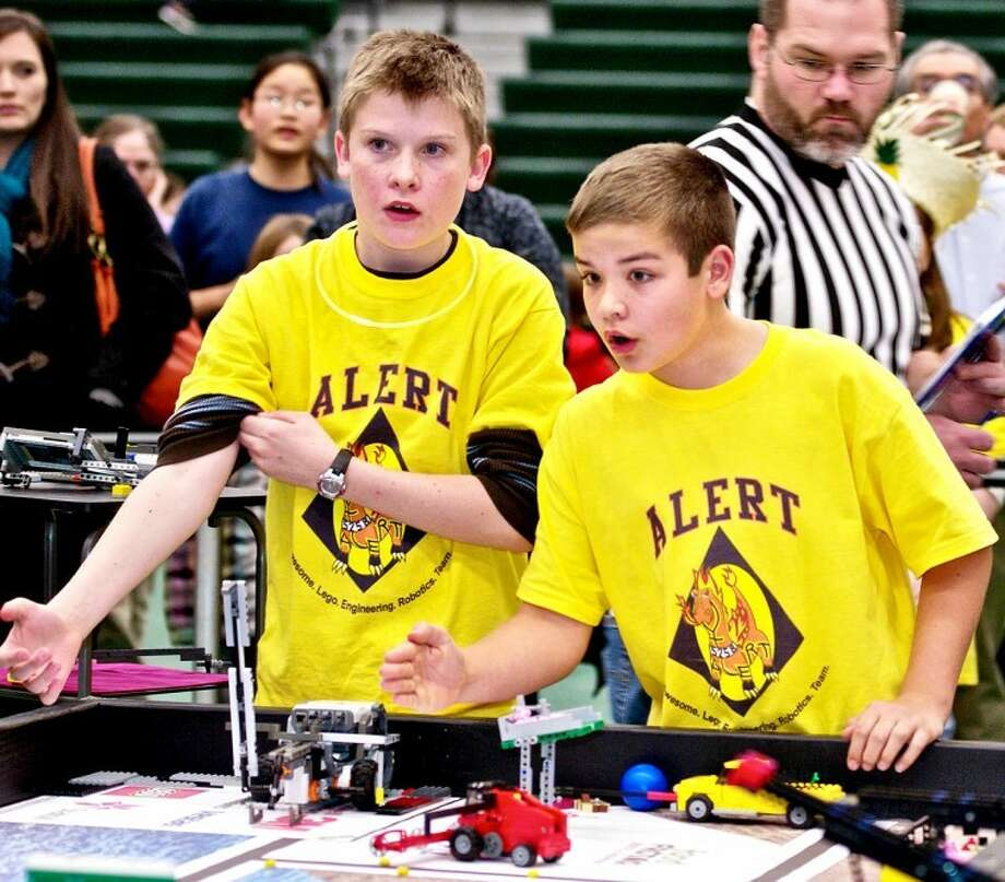 LAMONT LENAR   for the Daily NewsABOVE: Garrett Lanker (left) and Kaden Gretka of team ALERT ( Awesome Lego Engineering Team) prepare to start their robot in the Ready, Set, Lego Tournament held at Delta College on Saturday. Photo: Lamont Lenar