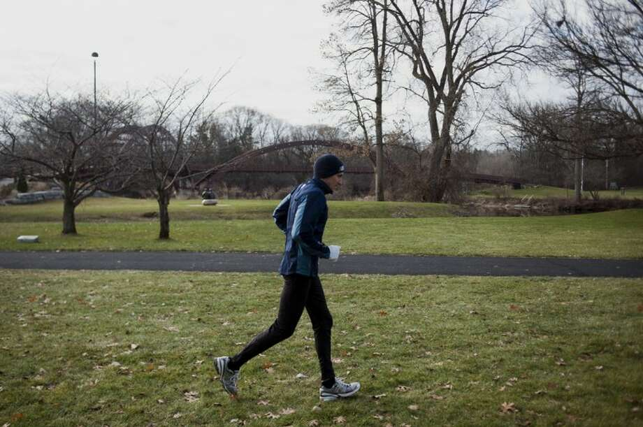 NEIL BLAKE | nblake@mdn.netBill Leibfritz of Midland starts a nine mile run on Wednesday morning near the Tridge. He has run every day for the past 30 years, often utilizing the Pere Marquette Rail-Trail and the Chippewa Nature Center trails. Photo: Neil Blake