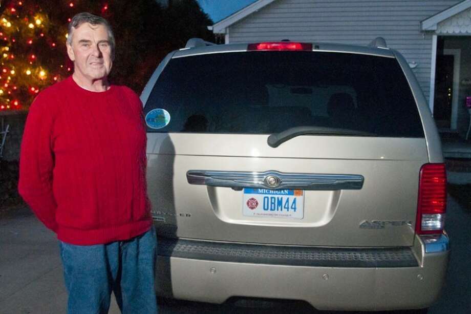 "AP Photo | The Bay City Times, Lathan GoumasGary Mueller stands with his Chrysler Aspen at his home in Bangor Township. Mueller is occasionally approached by people asking if his license plate, which reads ""OBM44,"" is a reference to President Barack Obama, the 44th president of the United States. Mueller says that the letters and numbers on the license plate are just a coincidence. Photo: Lathan Goumas"