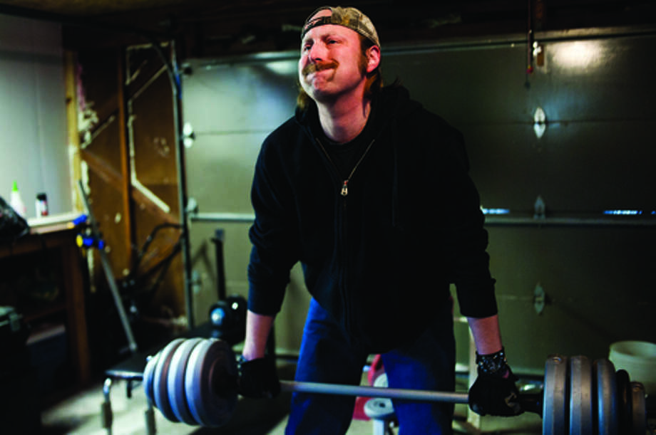 NEIL BLAKE | nblake@mdn.netJason Hafelein does deadlifts with 116 pounds while working out in his garage. In May, he underwent a double lung transplant and got rid of his diseased lungs. He is converting the garage into a home gym and is installing insulation and drywall when he gets a chance. Photo: Neil Blake / Midland Daily News | Neil Blake