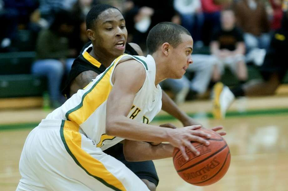 Dow's Malik Garner, right, moves past Saginaw's Jeffery Hill during the second period Friday at Dow High School. Photo: NICK KING   Nking@mdn.net