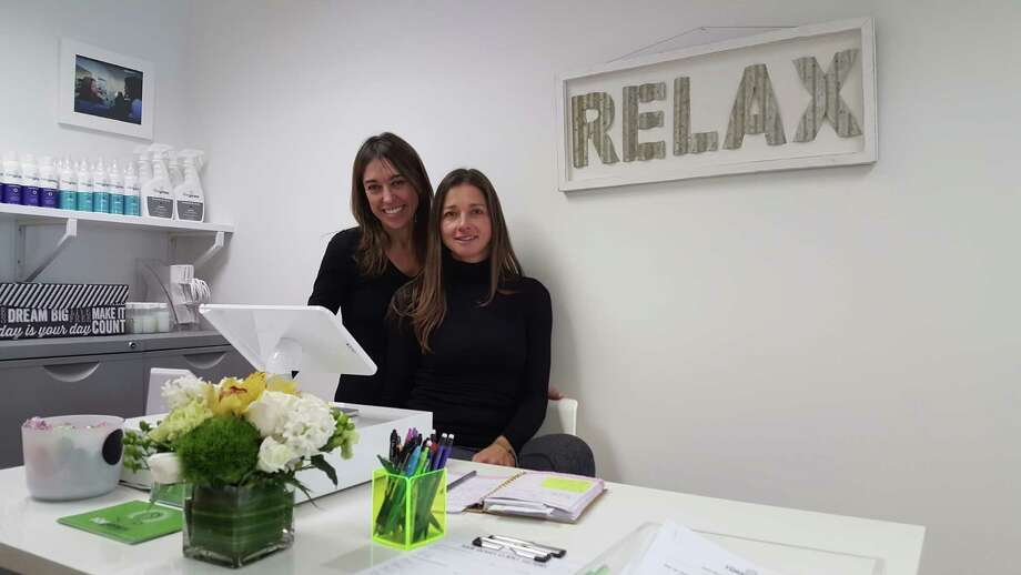 Allyson Greifenberger, left, and Kristy Gordon, co-owners of The Hair Genies, a lice treatment salon, in their new store at 228 Mill Street in Greenwich. Photo: Contributed Photo / Greenwich Time Contributed