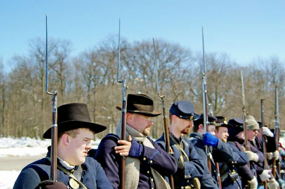 In a file photo from March 2011, Civil War reenactors drill outside Delta College. From left are Zach Schatzer, Will Eichler, Tom Steele, Mack Kerridge, Jeremy Bevard and Beau Shaver. Reenactors, who drilled with reproductions of Civil War rifled muskets, honored the memory of a unit recruited mainly at Saginaw. That was the Saginaw City Light Infantry, also known as Company K of the Fifth Michigan Infantry Regiment. Photo: STUART FROHM | For The Daily News