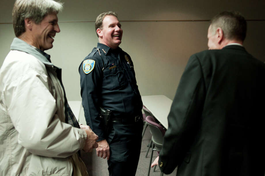 Midland Police Chief Gerald Ladwig, center, laughs with Jack Duso, left, and City Attorney Jim Branson at a retirement party at the Midland Law Enforcement Center on Wednesday. Duso is a new retireee as well. He retired as from his role as the assistant city manager for the City of Midland last month. Ladwig is retiring after 23 years of service at the police department. Photo: NEIL BLAKE | Nblake@mdn.net  / Midland Daily News | Neil Blake