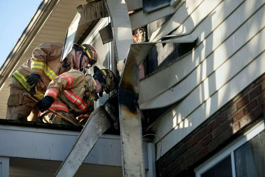 THOMAS SIMONETTI | tsimonetti@mdn.netMidland firefighters work the scene of a Monday afternoon fire at Eastlawn Arms Apartments in Midland. Photo: Thomas Simonetti