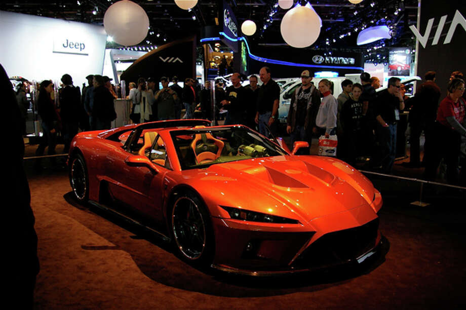 A burnt orange F7 from Falcon Motor Sports of Holly was assembled in Michigan and is almost entirely a Michigan car,  company president Carl Lemke said.The largely hand-built car — bought by a New York man — is the first in an expected first-year production run of approximately 10 vehicles. Target price for the cars is between $19,500 and $250,000. Lemke's wife, Kathleen, is the company's secretary-treasurer. Son Jeffrey is chief designer. Photo: STUART FROHM | For The Daily News