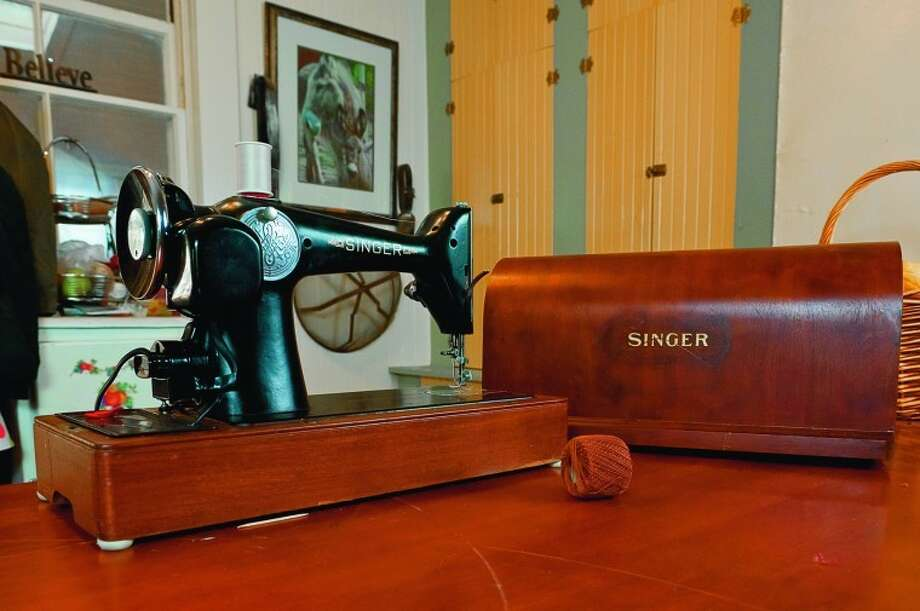 "John Rector, a former Midlander, has his mother's Singer sewing machine. He says it won't be long before his mom's great-granddaughter will use it.  ""She is 7 and probably is ready to start using it without sewing her little fingers to the top of the machine."" Photo by John Rector"