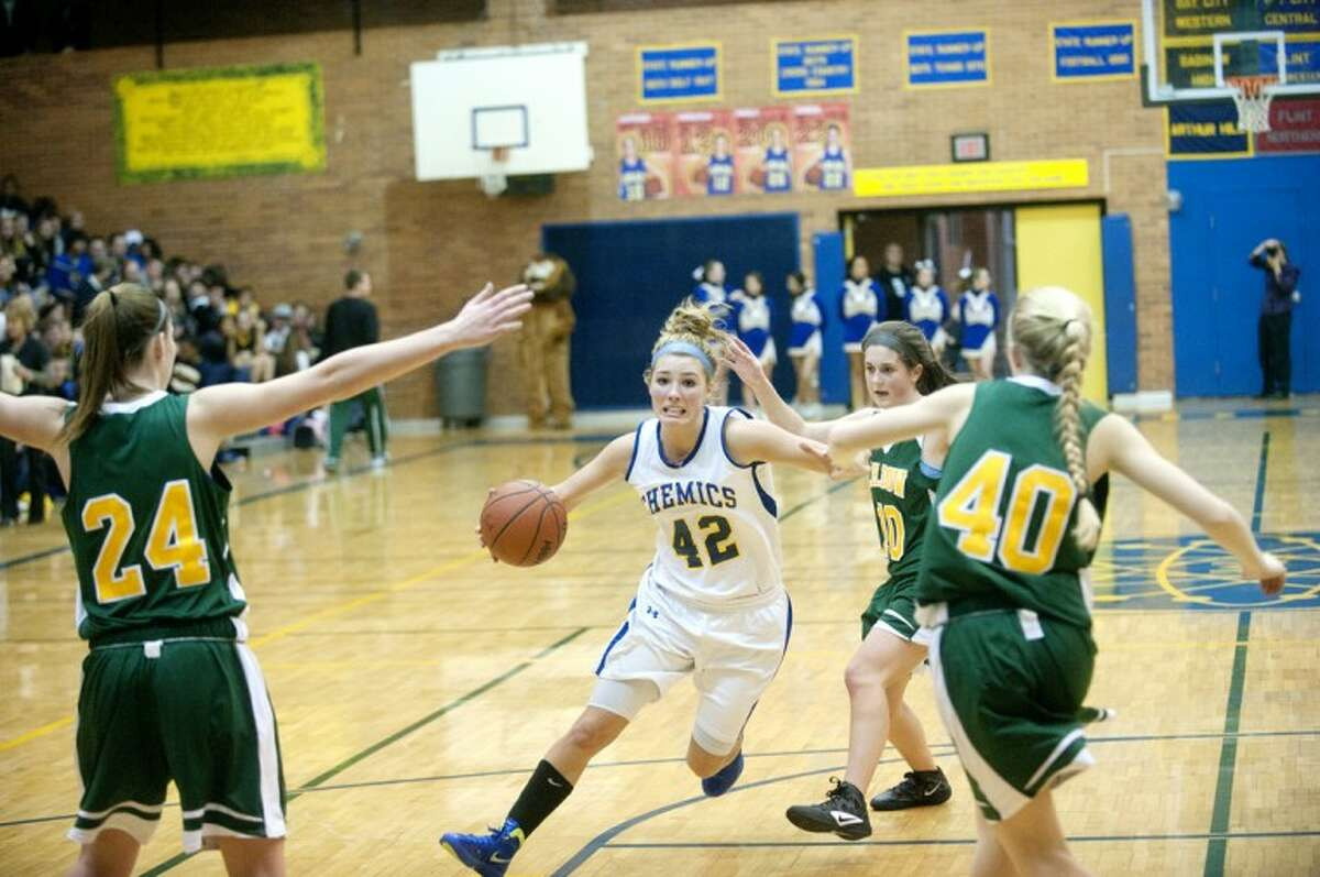 Midland's Jennifer Jarema drives to the hoop in Wednesday's rivalry game at Midland.