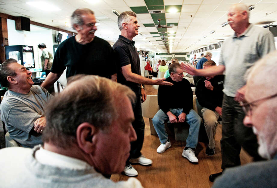 AP Photo | The Flint Journal | Ryan GarzaA group of men who went to Flint Northern High School together and graduated in the 1960s chat while bowling at Colonial Lanes in Mount Morris Township. The group has been bowling together once a week for about five or six years Photo: Ryan Garza / The Flint Journal