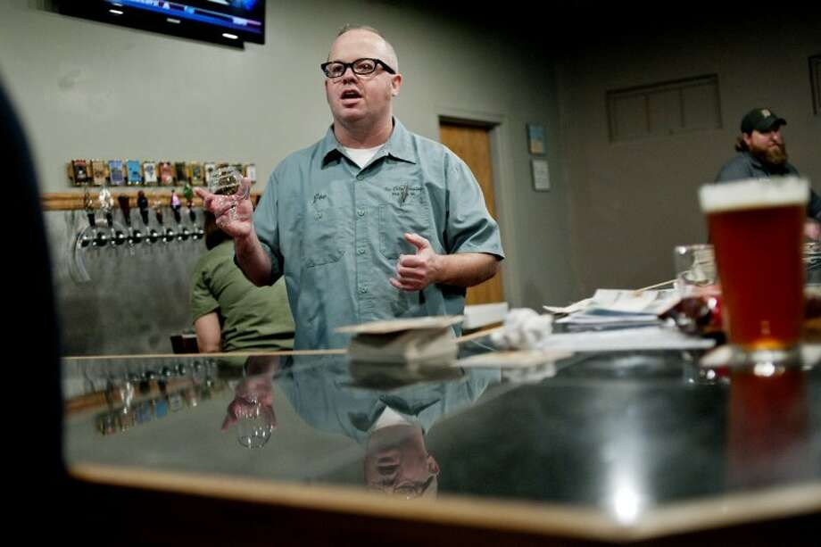 NICK KING | nking@mdn.netJoe Hackett takes orders behind the bar at the Tri City Brewing Co. taproom Thursday in Bay City. The taproom, which opened on Thursday, offers 12 different beers to sample. Tri City Brewing Co. is celebrating its fifth anniversary. Photo: Nick King\u002fMidland  Daily News