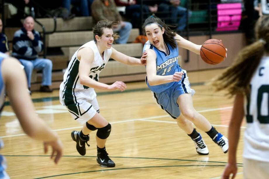THOMAS SIMONETTI | tsimonetti@mdn.netMeridian's Bri Yaroch, right, tries to dribble around Clare's Ashley Petree.