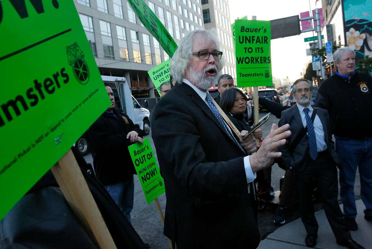 Tim Paulson, Executive Director of the San Francisco Labor Council addresses Teamsters after a protest against Bauer's Intelligent Transportation shuttles at a Muni stop used also for tech buses on 8th and Market streets March 22, 2016 in San Francisco, Calif.
