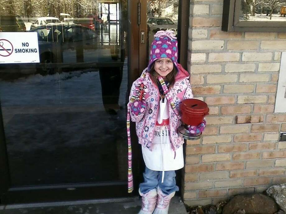 Photo providedHannah O'Neil, daughter of Salvation Army Captain Matt O'Neil, helps out with the fundraising effort.
