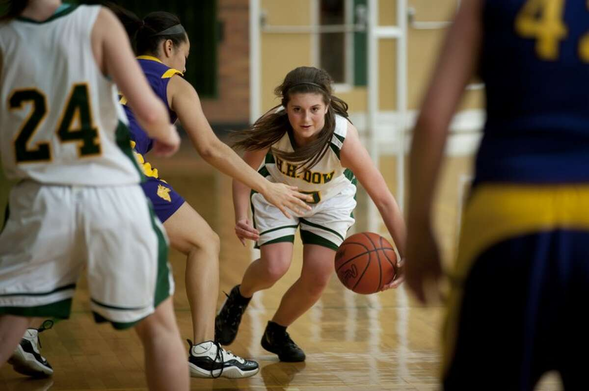 Dow High guard Kristine Mussell takes the ball up the court Friday against Bay City Central at the Dow High gym.