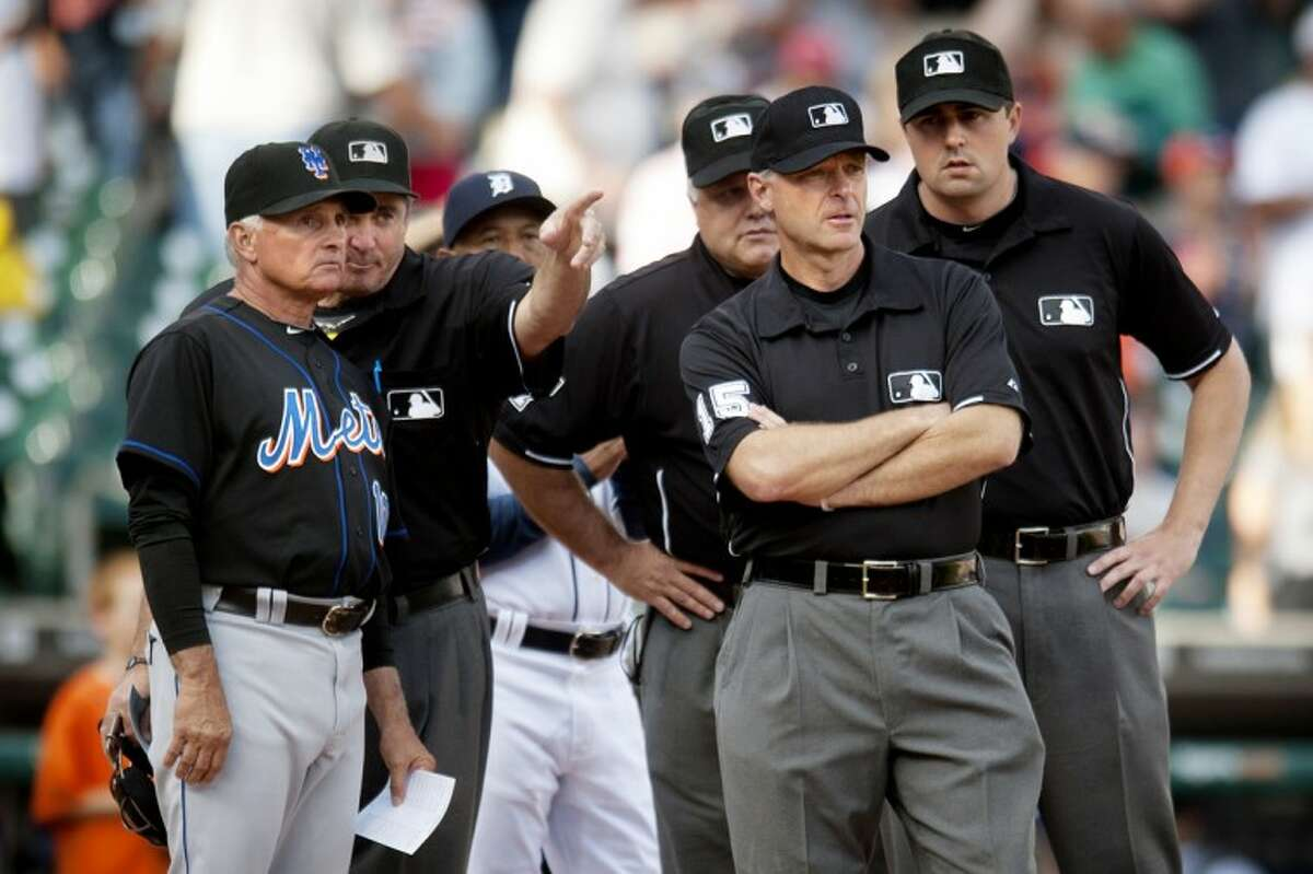 New York Mets manager Terry Collins, a Midland native, talks with the umpire crew before Tuesday's game against the Tigers at Comerica Park.