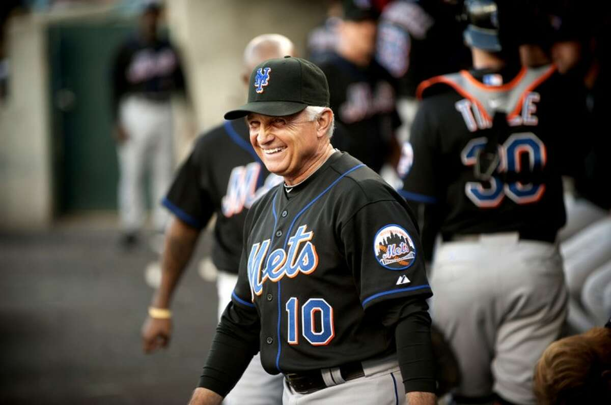New York Mets manager Terry Collins, a Midland native, laughs with players inside the visiting dugout at Detroit's Comerica Park on Tuesday. Collins and the visiting Mets had a lot of success against the Tigers, winning 14-3 in the first of a three-game series.