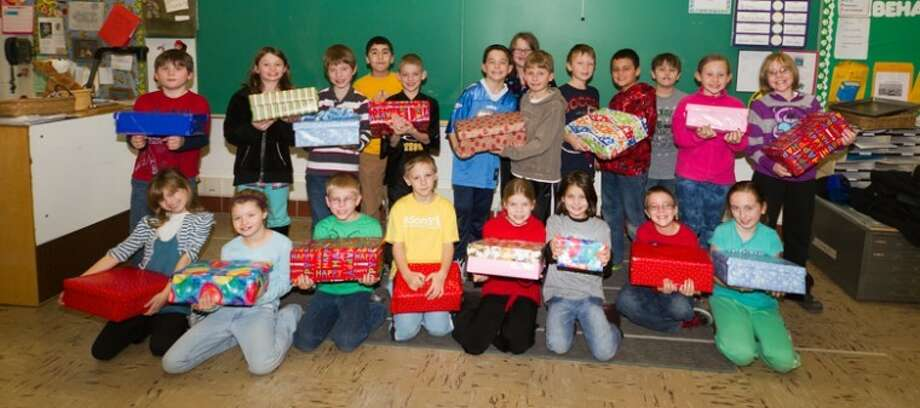 Photo providedTeacher Pam Schmidt's third grade class at Siebert Elementary School worked to fill and wrap birthday boxes donated to Shelterhouse.