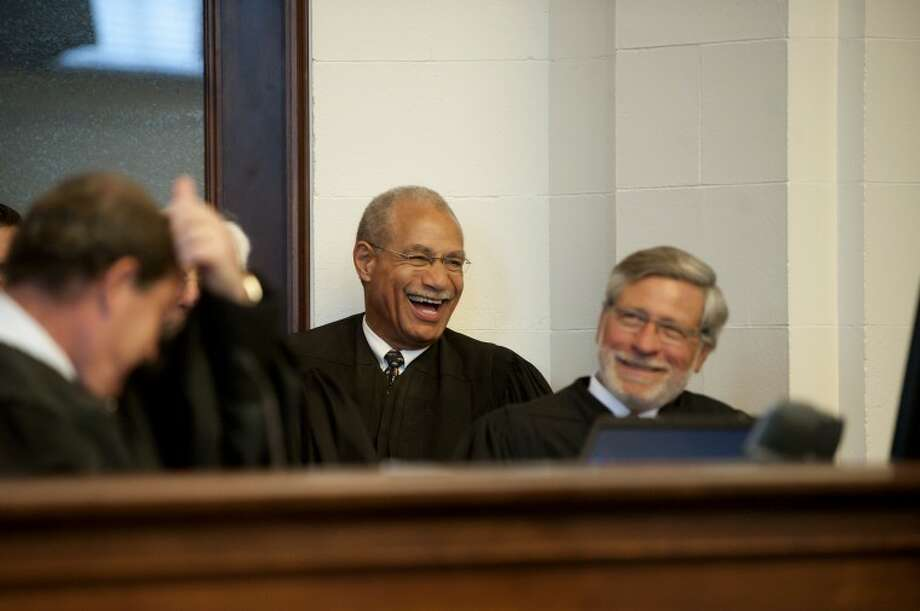 NEIL BLAKE | nblake@mdn.netJudge Gershwin A. Drain laughs with federal judges of the U.S. District Court. Judge Drain is a recent addition to the court and was confirmed by the U.S. Senate this August. Pictured on the right is Judge Thomas L. Ludington of Midland. Photo: Neil Blake/Midland  Daily News