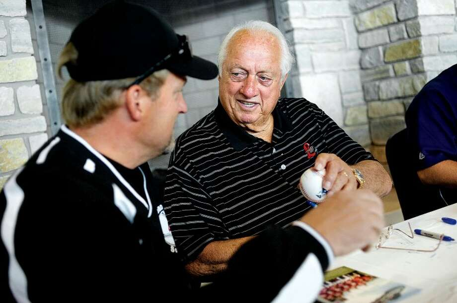 NICK KING | nking@mdn.net National Baseball Hall of Fame inductee and legendary former Dodgers manager Tommy Lasorda, right, signs a ball for Ben Shores, of Bay City, Tuesday before the Loons game against Bowling Green at Dow Diamond. Shores, who used to live in California, saw games when Lasorda was managing. Green beat the Loons 8-6. Photo: NICK KING | Nking@mdn.net