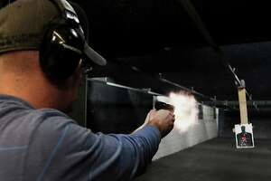 A customer fires a Ruger handgun at a gun range in Springville, Utah. In a letter sent to the SEC, New York City's public advocate said Sturm, Ruger had misled investors about who used its products and had not adequately disclosed the reputational and liability risks it faced.