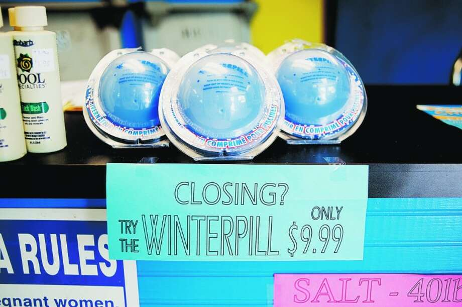 NICK KING | nking@mdn.net A-1 Outdoor Products offers a variety of items to get your pool ready for the fall and winter including winter pills that release all your need to keep your pool good during the off months. Photo: Nick King/Midland  Daily News