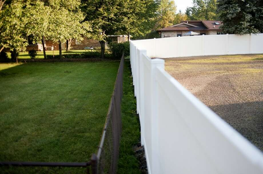 NICK KING | nking@mdn.netKJP Sales, Inc. offers privacy fences like the one seen on the right of the photo. The vinyl fences offer homeowners privacy from neighbors and other distractions.