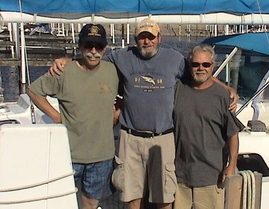 "Photo courtesy of Dan SchweitzerDan Schweitzer, Greg Bartlett,  and Brad Gordon alongside the Now What? nearing the end of their sailing trip. They titled this photo ""the party's over."""