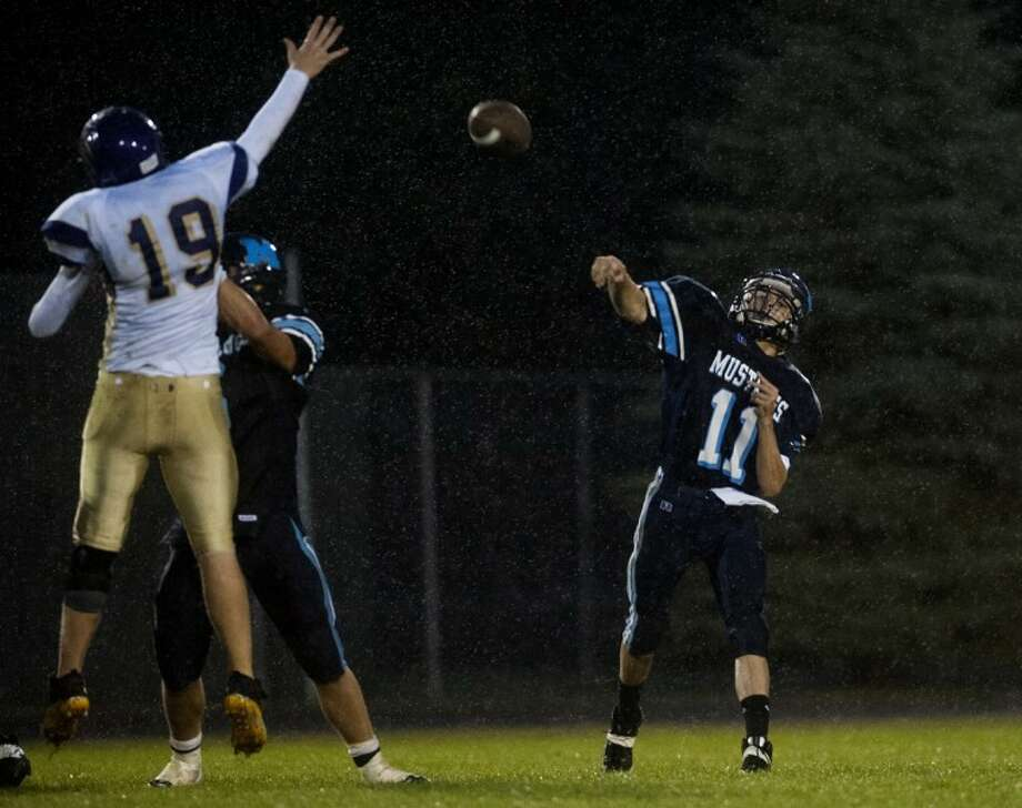 NEIL BLAKE | nblake@mdn.netMeridian quarterback Christian Petre throws the ball as Farwell's Taylor Larrabee tries to block it during the game at Meridian High School on Friday. For more photos of the Meridian game against Farwell, click on the following link: http://mdn.mycapture.com/mycapture/folder.asp?event=1529841&CategoryID=36149&ListSubAlbums=0 Photo: Neil Blake/Midland  Daily News