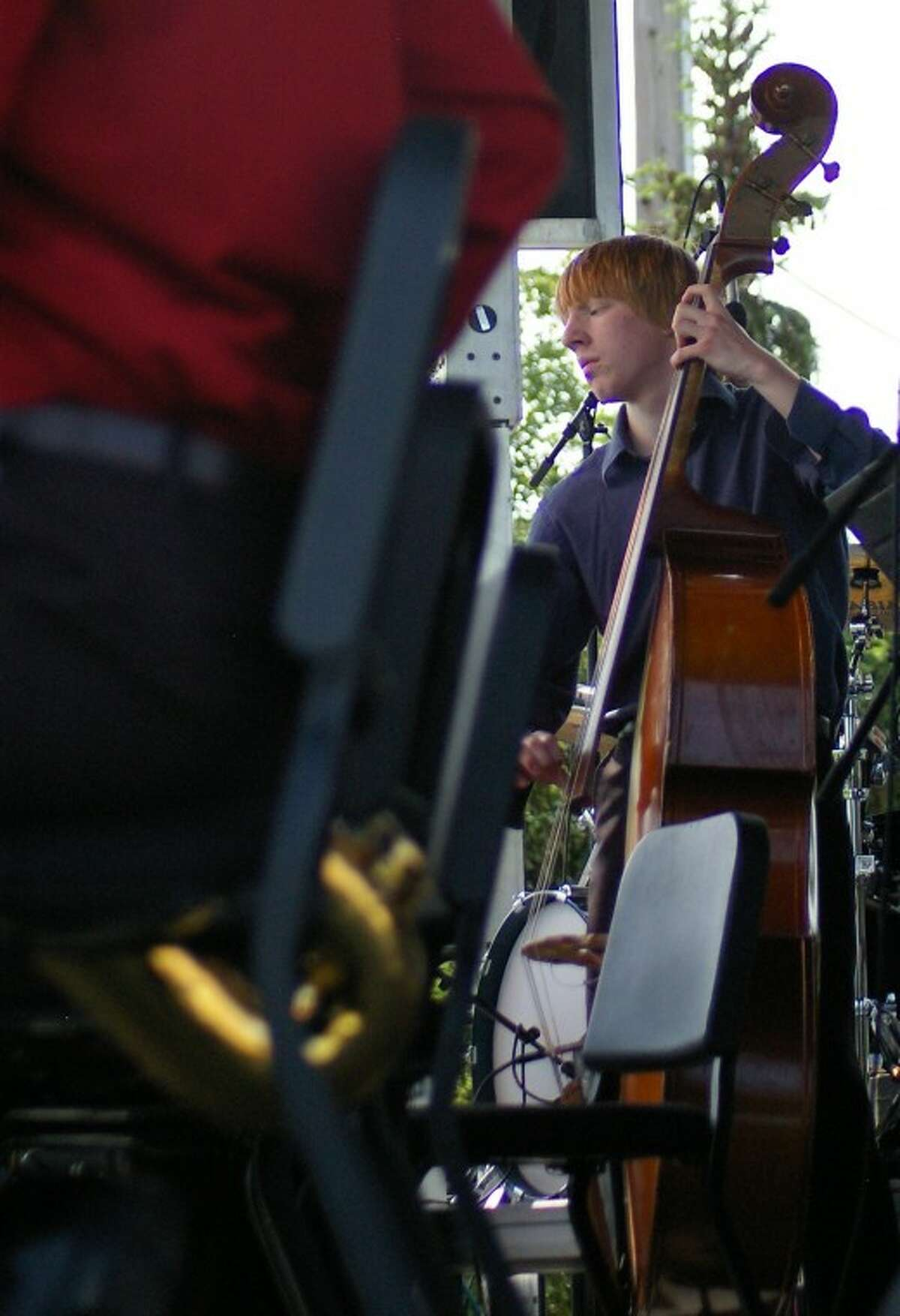 STUART FROHM   for the Daily NewsSam Kneibel, 16, plays bass with the Dow High Jazz Band Saturday afternoon during Jazz Trail in Midland.