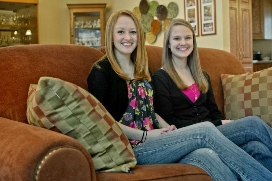 NICK KING | nking@mdn.netSaginaw Valley State student Heather Goodnight, 20, left, and her sister and Dow High School student Holly, 17, are going to Washington, D.C., for the presidential inauguration in January. Photo: Nick King/Midland  Daily News