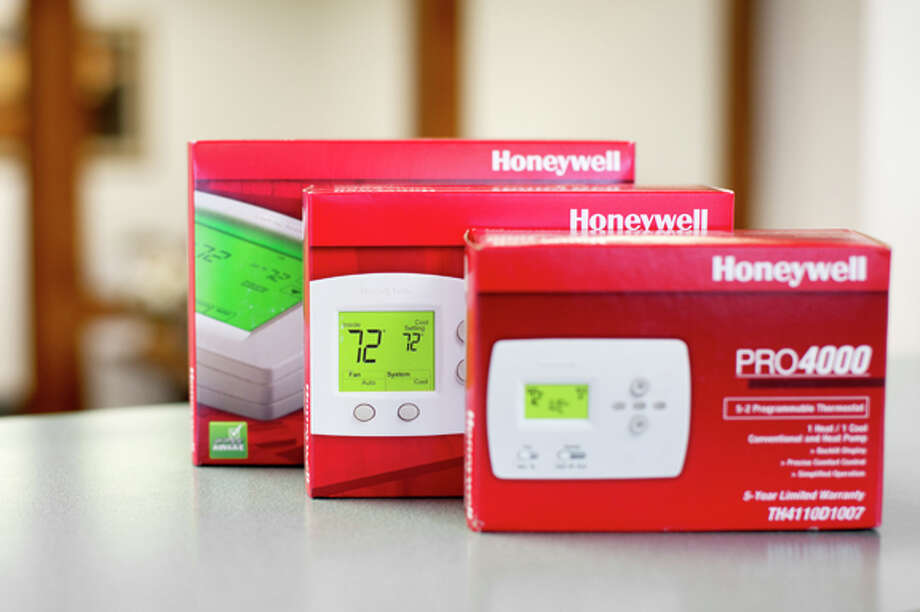 NICK KING   nking@mdn.net Reliable Plumbing, Heating, Air Conditioning offers the Honeywell line of automatic thermostats. The 8000 model features a touch screen; the 5000 and 4000 models are smaller and feature button controls. Photo: Nick King/Midland  Daily News / Midland Daily News