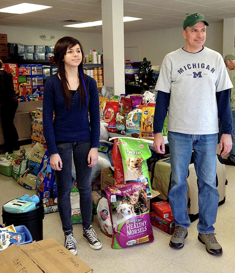 Provided photoCassidy Anlas and her father Thomas Anlas of Midland pose for a photo at the Monmouth County SPCA in Eatontown, New Jersey, over the Thanksgiving Day weekend. The Anlases helped generate donations for a pet food and supply drive for animals displaced by Super Storm Sandy.