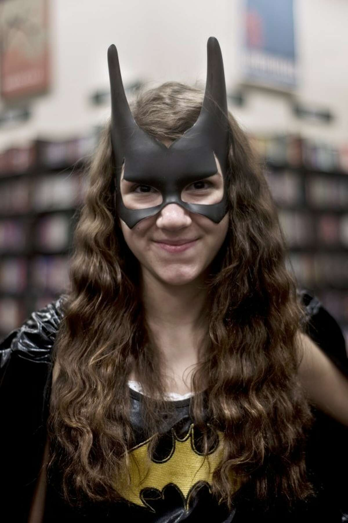 SEAN PROCTOR | sproctor@mdn.netRebecca Clark, 14, of Midland, dressed as Batgirl for Chestnut Hill Elementary's PTO fundraiser at Barnes and Noble.