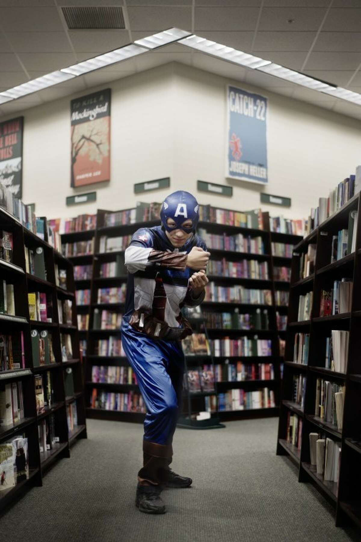SEAN PROCTOR | sproctor@mdn.netAdam Weckle, 17, of Midland, dressed as Captain America for Chestnut Hill Elementary's PTO fundraiser at Barnes and Noble.