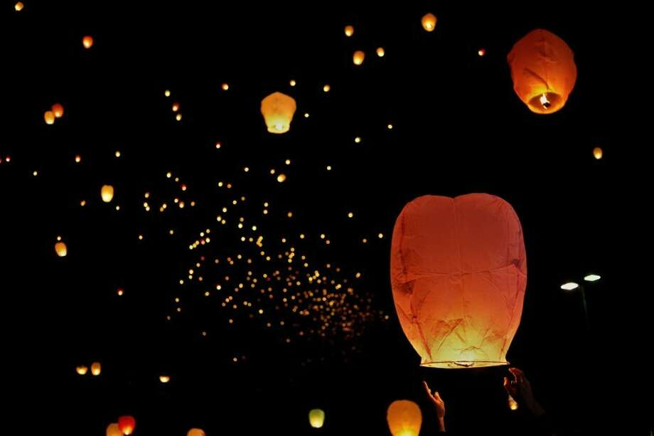 SEAN PROCTOR | sproctor@mdn.netHundreds of Chinese lanterns float up into the sky in honor of Jayden Lamb's ninth birthday Wednesday evening at Messiah Lutheran Church. Photo: Sean Proctor