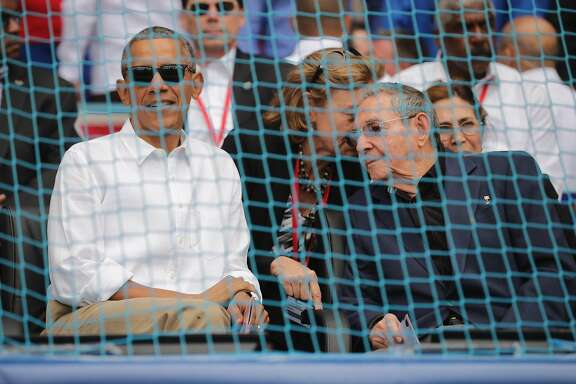 HAVANA, CUBA - MARCH 22:  U.S. President Barack Obama (L) and Cuban President Raul Castro arrive for an exposition game between the Cuban national team and the Major League Baseball team Tampa Bay Devil Rays at the Estado Latinoamericano March 22, 2016 in Havana, Cuba. This is the first time a sittng president has visited Cuba in 88 years.  (Photo by Chip Somodevilla/Getty Images)