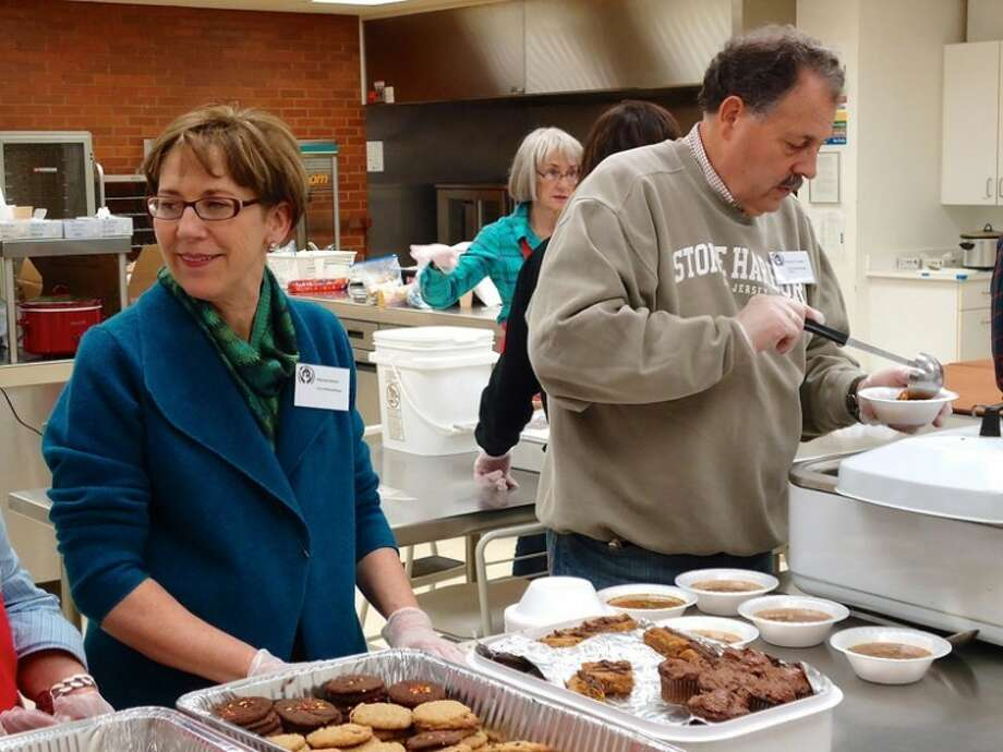 Photo providedMidland Mayor Maureen Donker was among local officials who served lunch at Project Housing Connect.