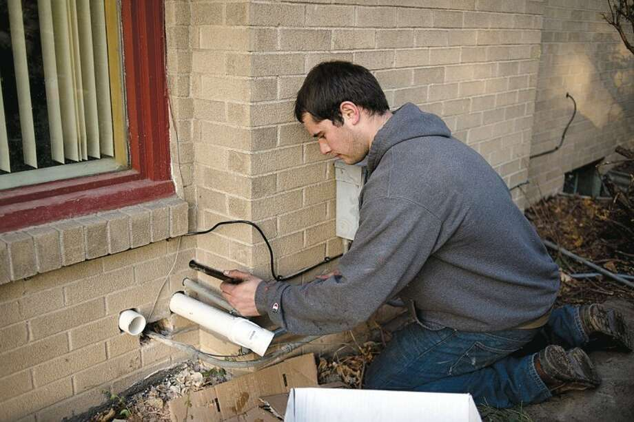 NEIL BLAKE | nblake@mdn.netTyler O'Dell, from Brubaker Plumbing, Heating, Air Conditioning and Fireplaces, works on the gas line to a new fireplace at a Midland home on Wednesday.