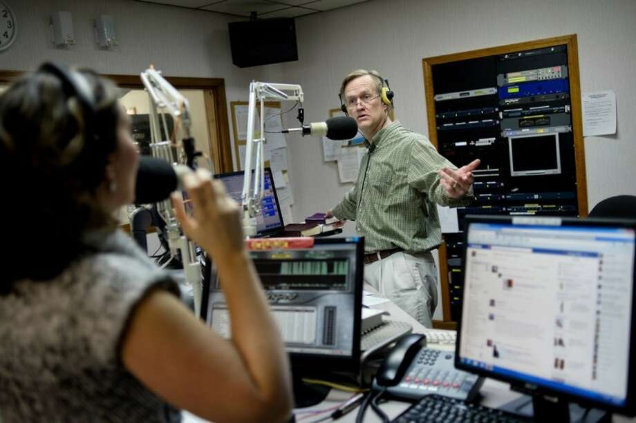 "NICK KING | nking@mdn.netRadio host Peter Brooks, right, reacts after he and co-host Shannyn Caldwell, left, realize it's time for the proverb of the day during the ""Peter and Shannyn"" in the Morning"" show at Family Life Radio in Midland. Peter, Shannyn and News Director Dennis Hutchinson have auditioned for a chance to compete on the national game show, ""The American Bible Challenge,"" hosted by Jeff Foxworthy. Photo: Nick King/Midland  Daily News"